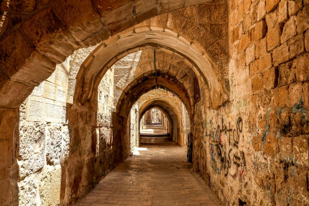 JERUSALEM, ISRAEL - JULY 7, 2014: Sreet of Jerusalem Old City Alley made with hand curved stones. Israel, Middle East